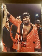 "Evander ""the real deal"" Holyfield signed 8x10 photo with COA"