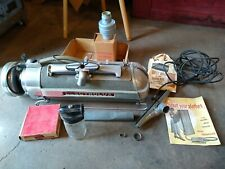 vintage canister vacuum Electrolux model XXX with many accessories
