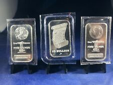 3OZ OF SILVER IN LOT,EA BAR 1OZ, UNC,PLASTIC WRAPPED,BRAND NEW