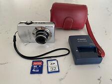 Canon PowerShot Digital ELPH SD880 IS / Silver Digital Camera / Red Camera Case