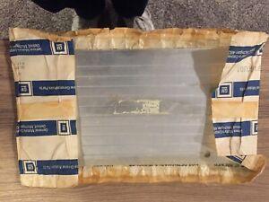 vintage cadillac ft plate filler.   nos in the original wrapper