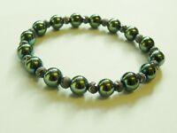Green hematite and gun metal grey spacer beads. Handmade stretch bracelet.