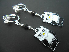 A PAIR OF CUTE BLACK AND WHITE ENAMEL OWL CLIP ON EARRINGS. NEW.