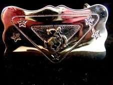 Bronco riding belt buckle with star design