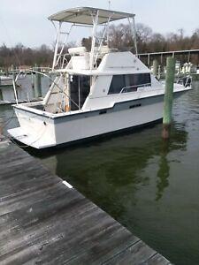 Siverton 34c in water, nice boat needs work NO RESERVE