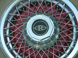 1977-78 Buick Riviera wire wheel covers, set (4), red, NOS!