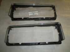PAIR of HEADLIGHT LAMP BEZELS 84-86 DODGE DAYTONA CHRYSLER LASER ORIGINAL MOPAR