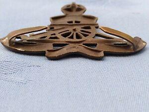 The Royal Artillery Officers Service Dress cap badge.