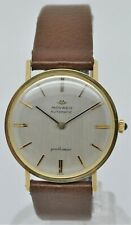 Movado gentleman micro-rotor automatic 18K gold dress watch