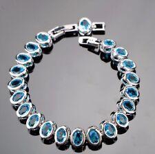 "925 Sterling Silver Blue Fire Topaz Stone Flanked  Tennis Bracelet Bangle. 7-8"""