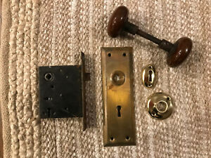 Antique interior mortise lock, brass rosette, key hole cover and door knob plate