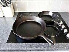 Two cast iron Lodge frying pans.