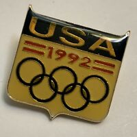 Lapel Pin Olympics 1992 USA Gold Tone Black Red Olympic Rings Good Condition