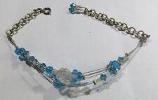 Bracelet plaqué argent avec perles bleu ciel et transparentes et 4 fils acier pl