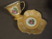 VINTAGE COURTING COUPLE AND BUTTERFLY TEACUP AND LEAF SAUCER MARKED JAPAN