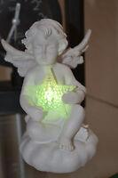Weiße Engelchen halten Farbwechsel-LED Stern,H-10cm