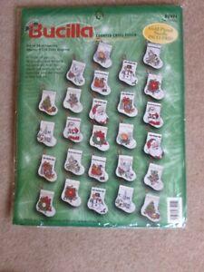 Bucilla cross stitch kit.  26 Christmas stocking ornaments.