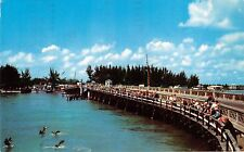 ST PETERSBURG FLORIDA JOHNS PASS BRIDGE~HOLIDAY ISLES~FINE FISHING POSTCARD 1959