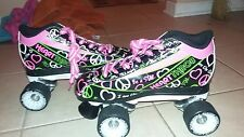 heart throb roller skates black and white and green and pink.