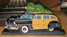 Shelia's Collectibles 1999 Bringing Home The Christmas Tree on the 1942 Woody