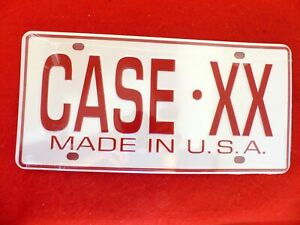 Case XX new shrink wrapped tan and burgundy license plate