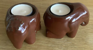 Two Small Brown Elephant Tea Candle Holders.