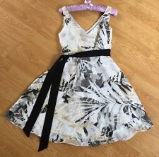 Ladies White Sleeveless Dress With A Black & Beige Floral Pattern Size 8-10