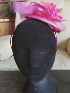 Fascinator - dark pink, flower with sinamay feathers on sinamay base on h/band
