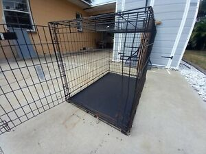 Large dog crate with plastic tray