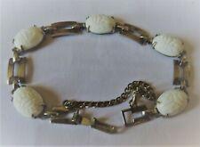Bracelet vintage en plaqué argent et pierres blanches à décor de scarabée