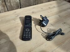 Samsung GT-E1190 with Charger. Very nice. Works great. Unsure whether locked.