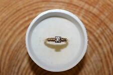 14K. YELLOW GOLD *** ROUND CUT DIAMOND SOLITAIRE RING 2.1 GRAMS .07 TCW.