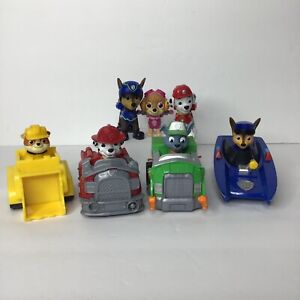 Paw Patrol Lot Of 7 Figures & Racers Skye Marshall Rubble Rocky Chase