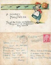 HALLOWEEN VINTAGE 1957 POSTCARD - GIRL w/ JACK-O-LANTERN