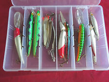 A PLASTIC TACKLE BOX WITH A COLLECTION OF LURES FOR PIKE, BASS ETC.