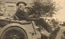 1920s or 30s photo of a man in an old vehicle