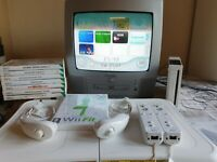 Nintendo Wii Bundle with Console, Fit Board, Nunchuck , Controllers and Games