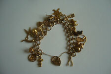 9ct gold  charm bracelet and padlock 18cm long. 35.2gms, 20 charms, used