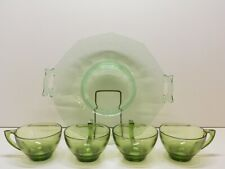 Green Glass serving tray with four glass tea/coffee cups.