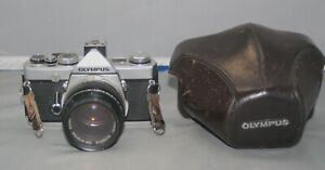 Olympus OM-1 35mm SLR Film Camera with 50mm Zuiko, 75-205mm telephoto lens, case