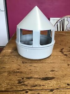 used poultry/chick feeder, plastic, divided into three sections