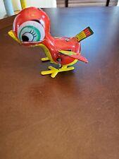 Vintage tin litho wind up toy bird