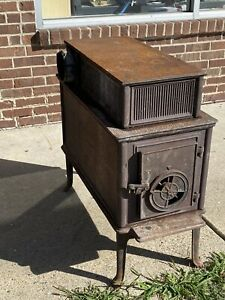 Vintage cast iron wood burning stove heater Pickup Only Michigan 48317