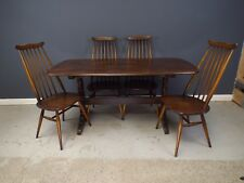 Ercol Dining Table and Matching Set of Four Chairs