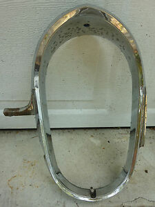1957 LINCOLN CAPRI PREMIERE LH HEADLIGHT BEZEL DRIVER SIDE