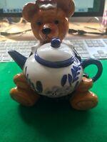 Teddy Bear holding teapot W15xD12xH16cm 400 grams