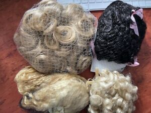 Four New Doll wigs