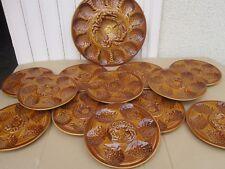 Plat et 12 assiettes à crustacés huîtres faïence de Sarreguemines .