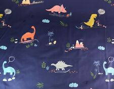 100% cotton poplin fabric, colourful dinosaurs on navy blue background.