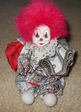 Stuffed clown figurine with painted cloth head, numbered